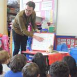 Writer Shane Strachan works with young learners to develop literacy.